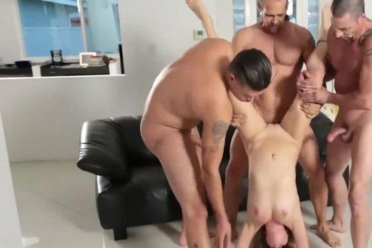 Три парня жестко ебут блондинку в письку и рот в необычных позах